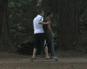 Ben and Josh take a little time to ride the longboard they build together last year after camp.