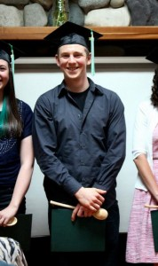 Ben with his graduation spoon and diploma