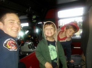 Happy faces in the fire truck!